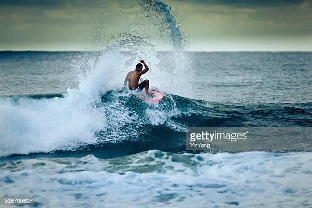 Surfer Surfing the Kauai Coast in Hawaii