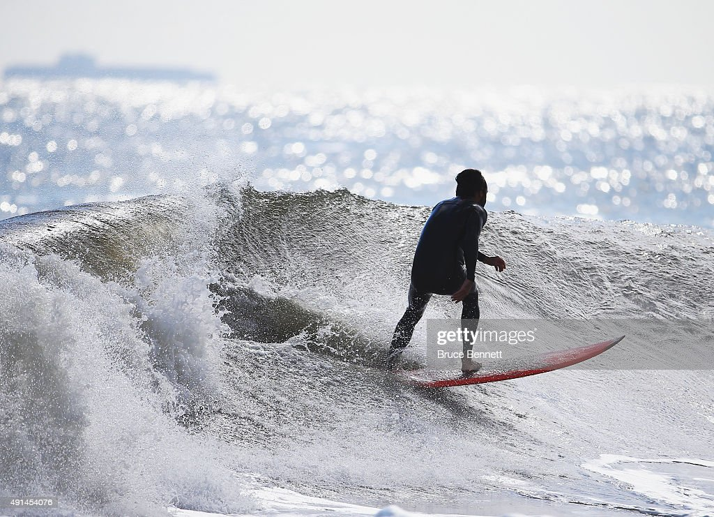 A surfer takes advantage of five to seven foot swells coming off the Atlantic Ocean on October 5 2015 in Long Beach New York The higher than average...