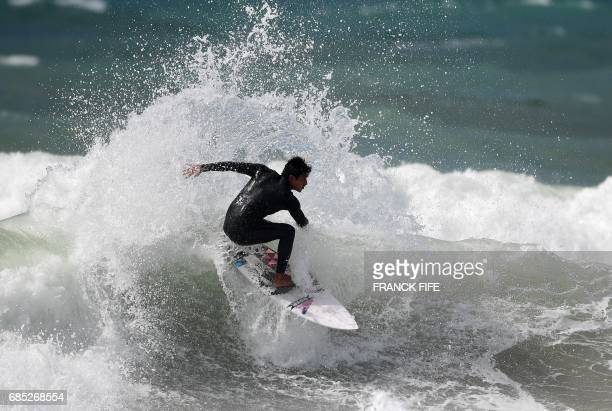 A surfer takes part in a training session on May 19 2027 in Biarritz southwestern France on the eve of the start of the 2017 ISA World Surfing Games...