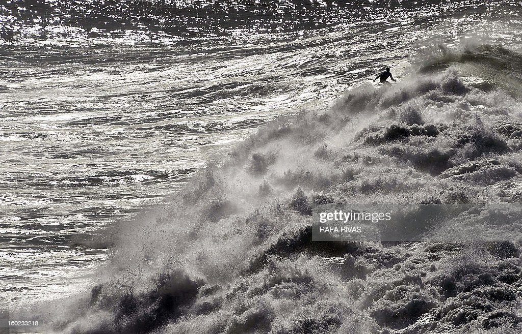A surfer takes part in the Arnette Punta Galea Big Wave World Tour, on January 28, 2013 in the Northern Spanish Basque town of Getxo. 16 surfers took part during the five hours surf competition, riding 5 meters high waves. AFP PHOTO/ RAFA RIVAS