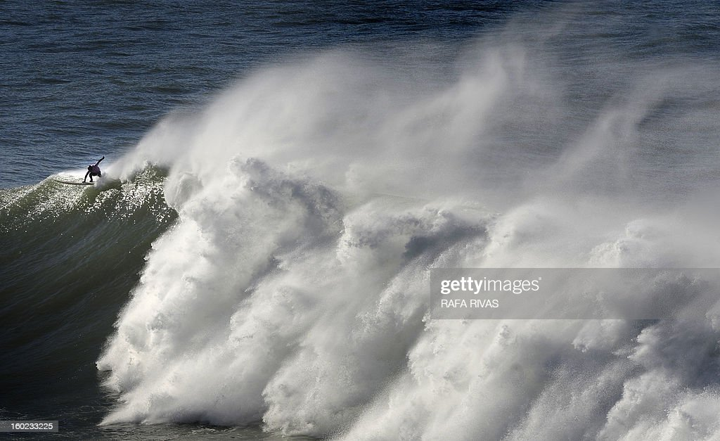 A surfer takes part in the Arnette Punta Galea Big Wave World Tour, on January 28, 2013 in the Northern Spanish Basque town of Getxo. 16 surfers took part during the five hours surf competition, riding 5 meters high waves.