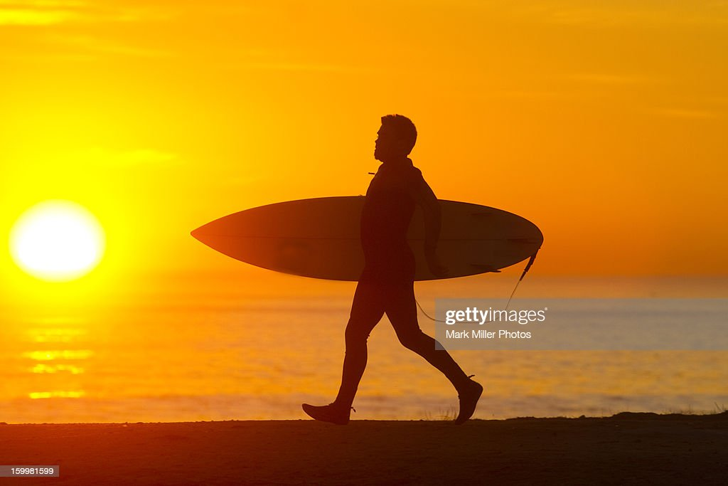 Surfer with Surf Board  at Sunset : Stock Photo