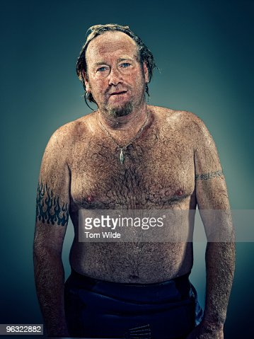 Surfer with wet hair and torso  : Stock Photo