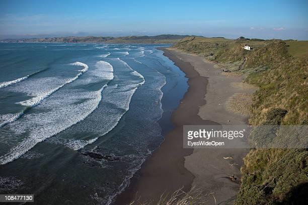 Surfers at Raglan Beach in Raglan New Zealand on November 29 North Island