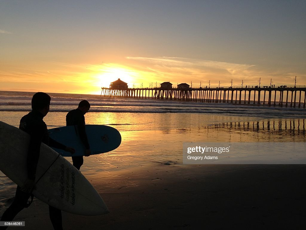 Huntington beach california stock photos and pictures getty images - Surfers At Sunset In Front Of The Wharf At Huntington Beach California