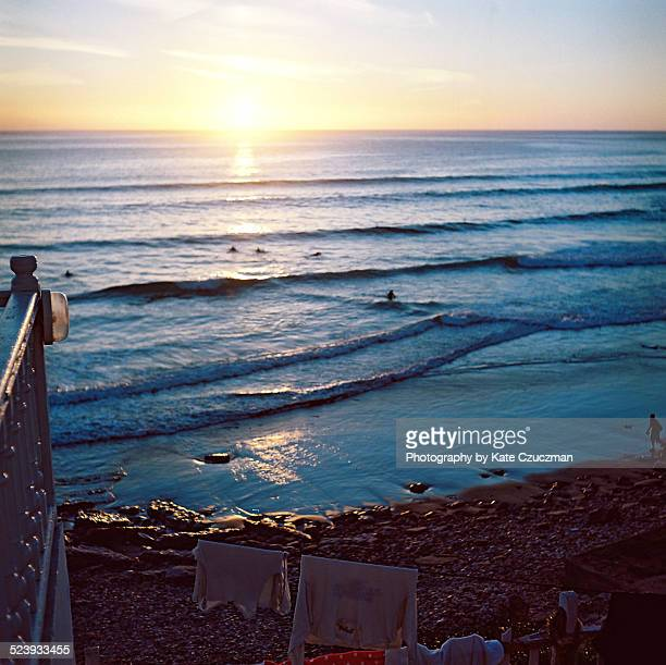 Surfers at sunset in Taghazout, Morocco