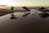 Surfers at sunset on the Mediterranean Sea.