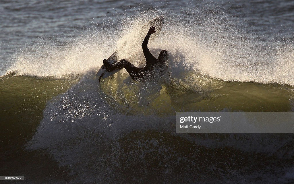 Surfers brave the cold to take advantage of the Cornish winter waves on January 20 2011 in Polzeath England Improved wetsuit materials and technology...