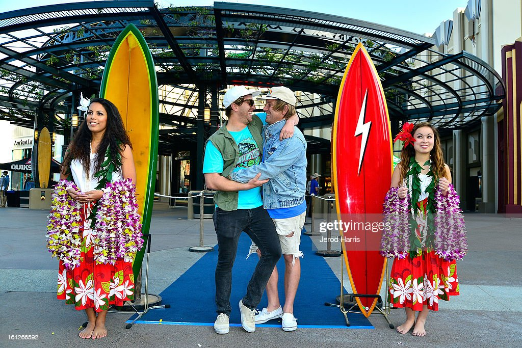 Surfers <a gi-track='captionPersonalityLinkClicked' href=/galleries/search?phrase=Chad+Marshall&family=editorial&specificpeople=2191131 ng-click='$event.stopPropagation()'>Chad Marshall</a> and Trace Marshall arrive at Disney's 'A Deeper Shade Of Blue' surfing documentary premiere at AMC Downtown Disney 12 Theater on March 21, 2013 in Anaheim, California.