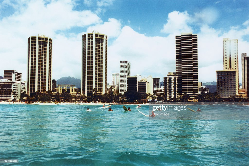 Surfers crowd in Hawaii beach : Stock Photo