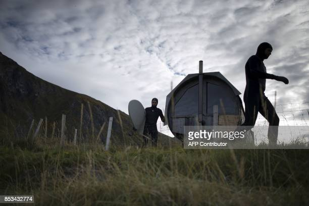 Surfers get ready next to the sauna during the Lofoten Masters 2017 the world's most northerly surf competition in Unstad's bay in the arctic circle...