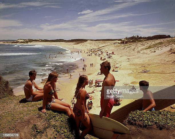Surfers & girls in bikinis, Soldiers Beach near Norah Head, NSW, Australia, 1960s