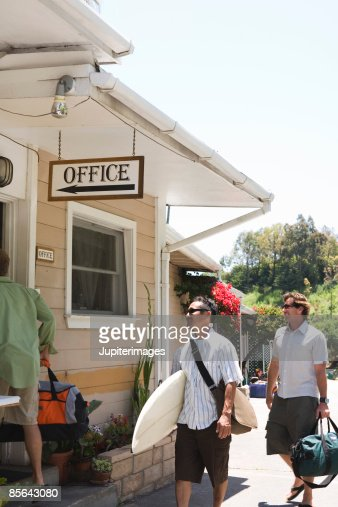 Surfers heading into motel office