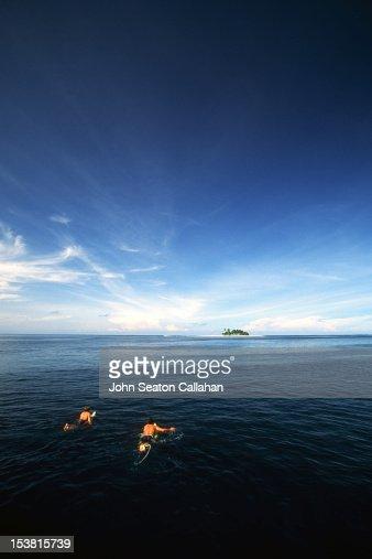 Surfers in Mentawai Islands