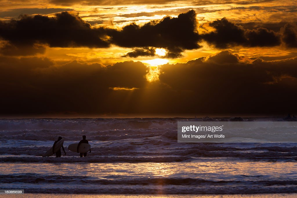 Surfers on Cannon Beach, Oregon, USA : Stock Photo