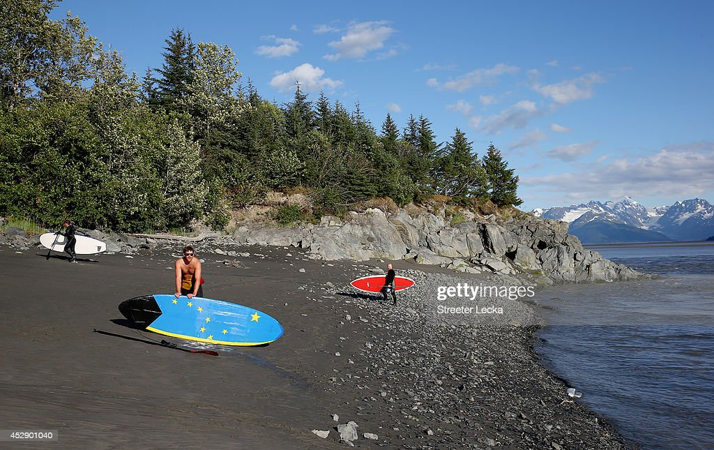 Surfers pack up for the day along the Seward highway after surfing the Bore Tide at Turnagain Arm on July 14, 2014 in Anchorage, Alaska. Alaska's most famous Bore Tide, occurs in a spot on the outside of Anchorage in the lower arm of the Cook Inlet, Turnagain Arm, where wave heights can reach 6-10 feet tall, move at 10-15 mph and the water temperature stays around 40 degrees Fahrenheit. This years Supermoon substantially increased the size of the normal wave and made it a destination for surfers.