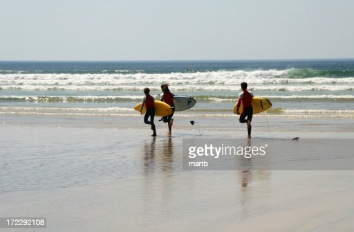 Surfers Race for the Waves