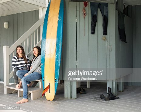 Surfers relaxing on patio