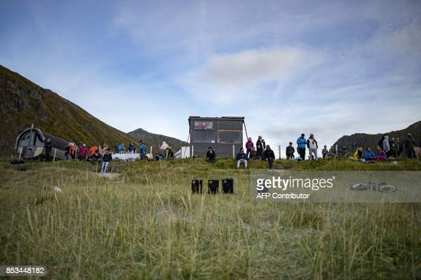 Surfers rest during the Lofoten Masters 2017 the world's most northerly surf competition in Unstad's bay in the arctic circle on September 22 2017...