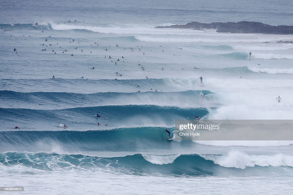 Surfers ride waves at Snapper Rocks on February 20 2015 in Gold Coast Australia Tropical Storm Marcia intensified to a Category 5 storm as it made...