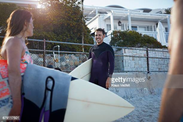 Surfers smiling at the beach