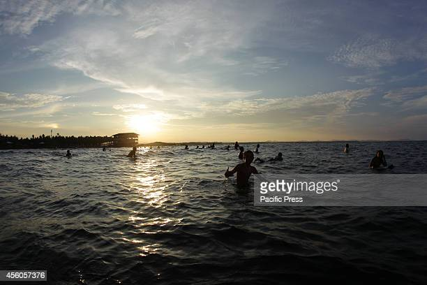 Surfers wait for waves in Cloud 9 Siargao a day before the Siargao Cloud 9 Surfing Cup on September 24 2014 This year's Siargao Cloud 9 Surfing Cup...