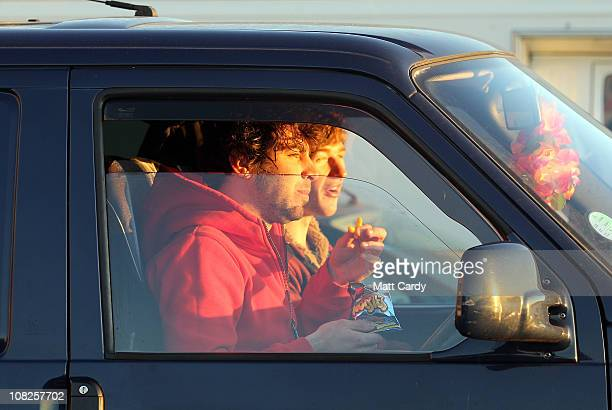 Surfers watch from their parked cars above the beach the Cornish winter waves on January 20 2011 in Polzeath England Improved wetsuit materials and...