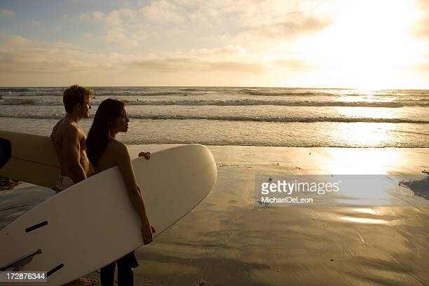 Surfers Watching Sunset 2