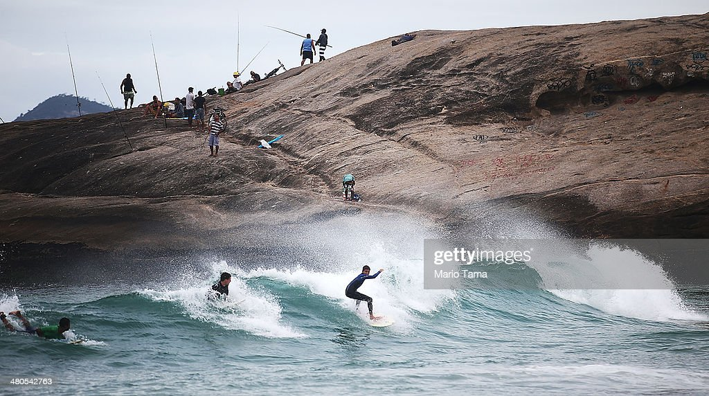 Surfers wide a wave near Arpoador Beach on March 25, 2014 in Rio de Janeiro, Brazil. Autumn has arrived in Rio bringing with it much needed rains and increased surf in some areas.