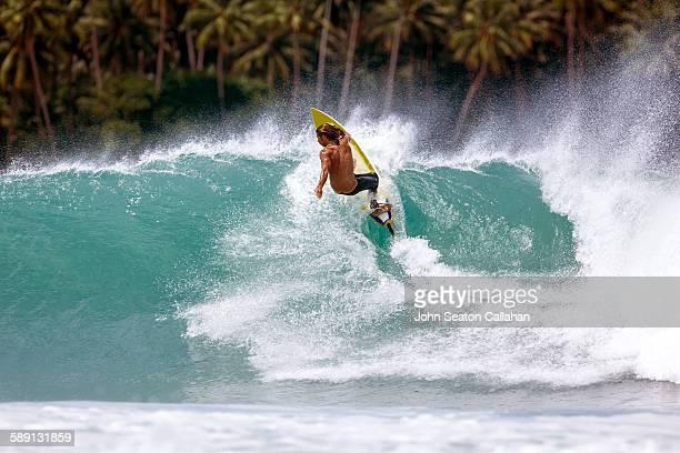 Surfing at Lagundri Bay