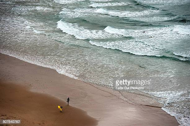 Surfing at Praia da Arrifana Beach of Algarve Region Portugal