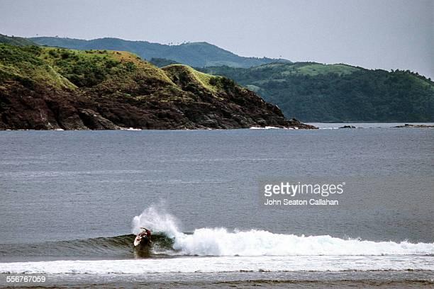 Surfing at Puraran Bay
