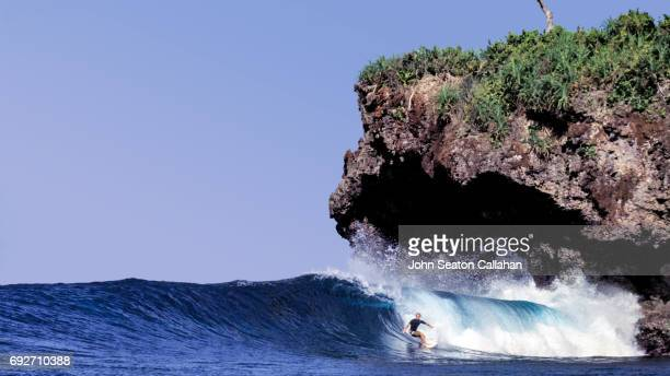 Surfing in the Pacific Ocean off Siargao Island
