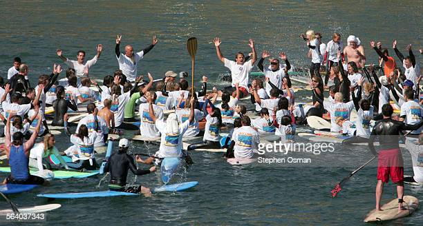 surfing legend laird hamilton right of paddle sticking up joined several hundred protesters on a paddle