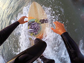Surfing on a wooden surfboard (point of view)