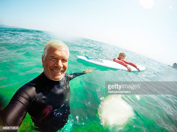 Surfing selfie of a senior couple