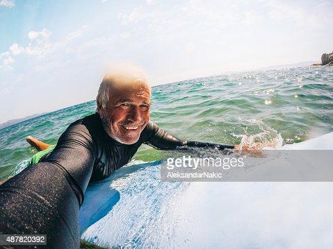 Surfing selfie of a senior man