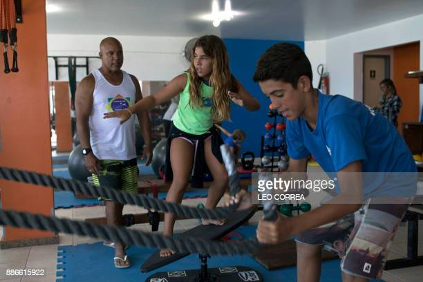 Surfing teacher Luiz Augusto de Matos conducts a training session at the 'Inside Fit' surf training centre in Saquarema Rio de Janeiro state Brazil...