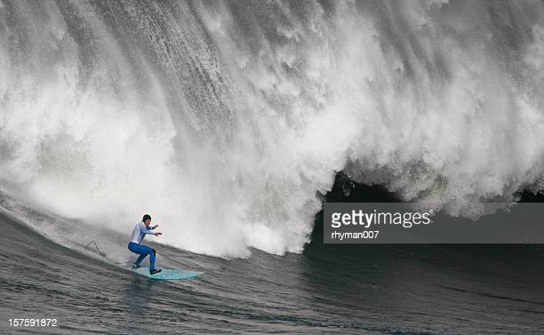 Surfing the curl of a huge wave