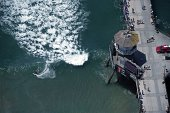 US Open of Surfing Aerial view of action during Men's 3rd Round alongside Huntington Beach Pier at Surf Stadium Photo shot from the Goodyear Blimp...