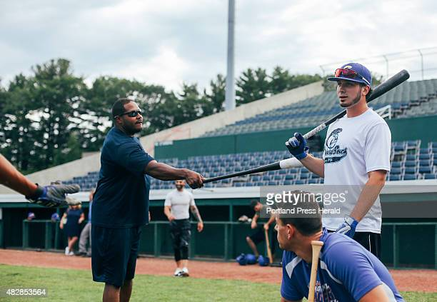 Surge coach Sandy DeLeon gets Skip Flanagan's attention by tapping his shoulder with a bat during practice in Old Orchard Beach ME on Wednesday July...