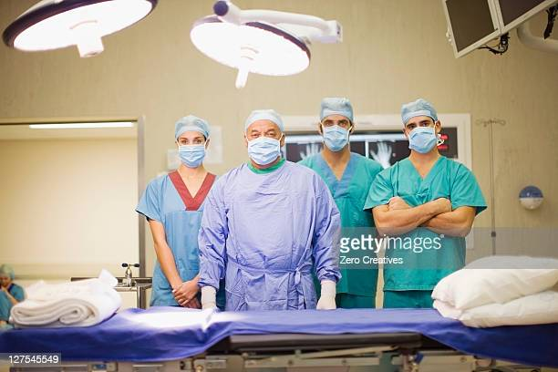Surgeon and nurses in operating room