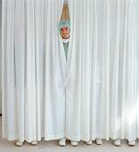 Surgeon Behind Curtains