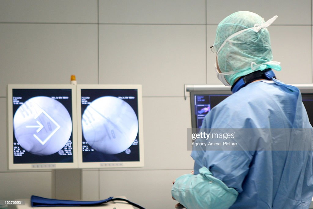 A surgeon in front of a X-Ray monitor on November 22, 2012 in Bad Abbach, Germany.