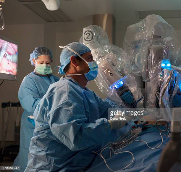 Surgeon performing robotic surgery.