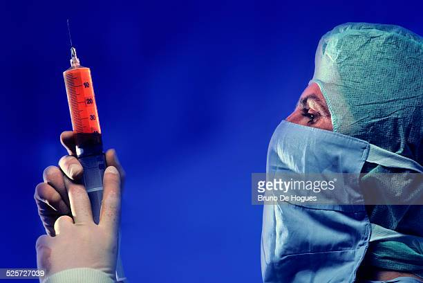 Surgeon preparing an injection