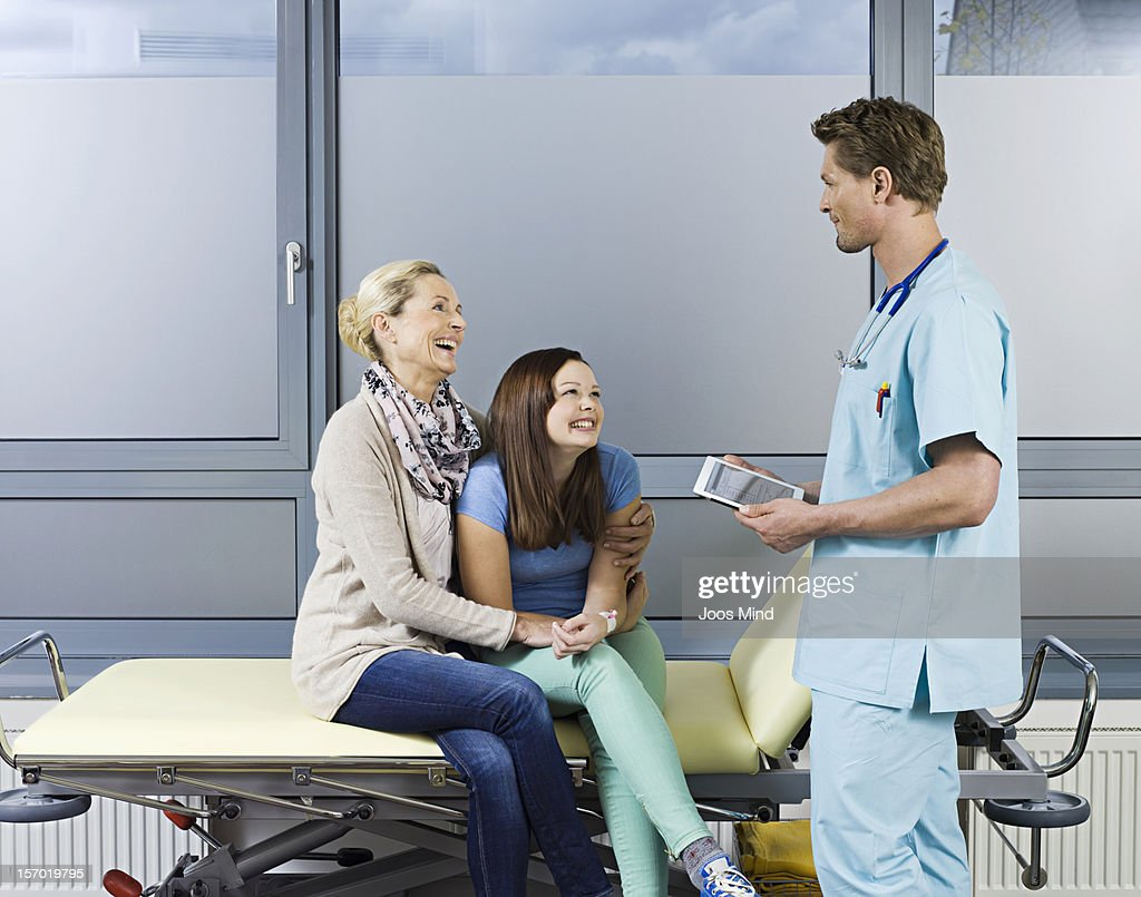 surgeon talking to mother and daughter : Stock Photo