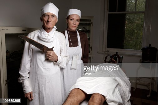 Surgeon with saw, antiquated theatre