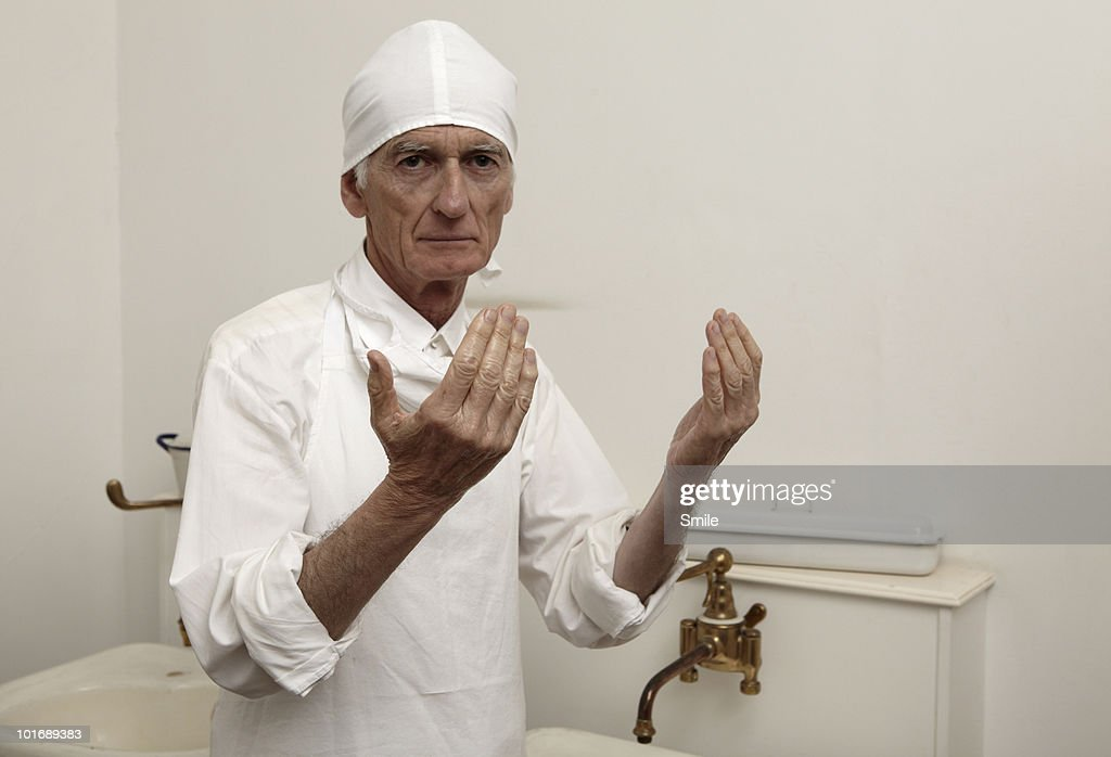 Surgeon with sterilized hands : Stock Photo