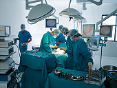Surgeons performing operation in operating room